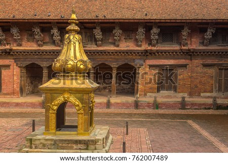 PATAN, NEPAL - September 23, 2013: Details of the historical part of the city Patan Durbar Square. Patan, ancient city in Kathmandu Valley.