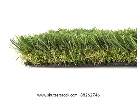 patch of green artificial grass on a white background - stock photo