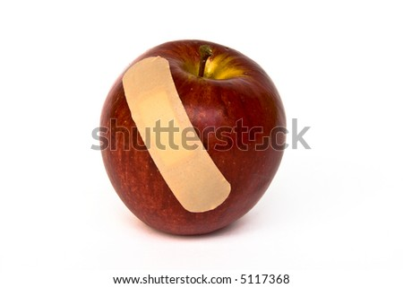 Patched apple, maybe hit by hail - stock photo