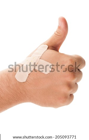 Patched hand showing OK sign on white background - stock photo