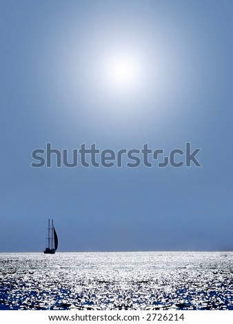 Patches of light on the sea on horizon it is visible a sailing vessel - stock photo