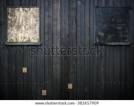 Patches on wooden hut