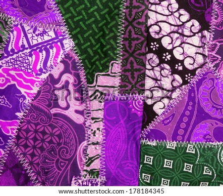 patchwork / quilt background from little textile parts stitched together  - stock photo