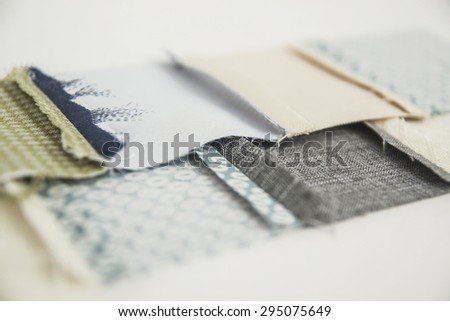 Patchwork sewing technology. Linking pastel cloth patches with cell pattern. Ironing a seam. A reverse side of a work. - stock photo