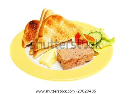 Pate and toast with salad garnish on a plate