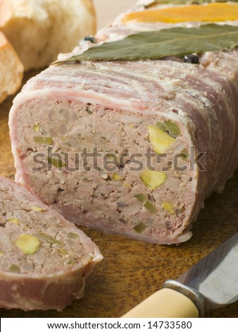 Pate Campagne on a Chopping Board with Rustic Bread - stock photo