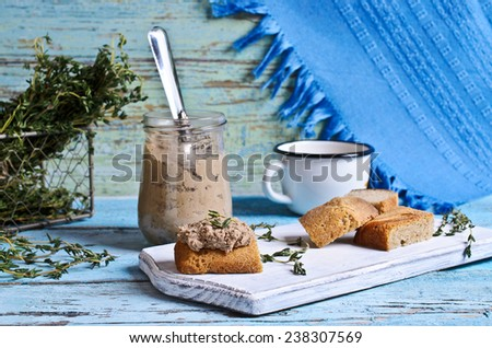 Pate chicken liver brown is lying on the piece of bread - stock photo