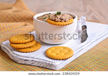 Pate chicken liver brown lies on a cracker - stock photo
