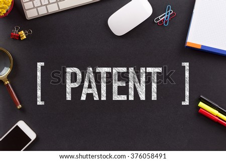 PATENT CONCEPT ON BLACKBOARD - stock photo
