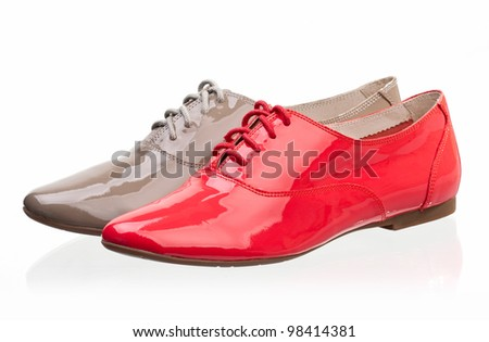 Patent leather women shoes against white background - stock photo