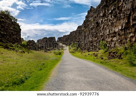 Path along fissure Almannagja at Thingvellir National Park in Iceland where the european and american continental plates drift apart - stock photo