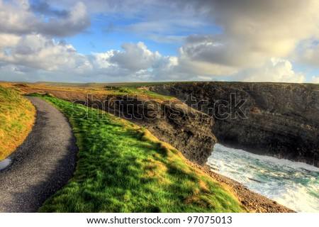 Path along the cliffs of Kilkee in Ireland. - stock photo