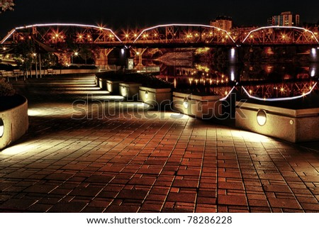 Path along the South Saskatchewan River in Saskatoon, Canada.  The area is lit up to give a modern feel to an old broken down area.  Processed using HDR. - stock photo