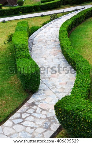 path and bushes in a beautiful park - stock photo