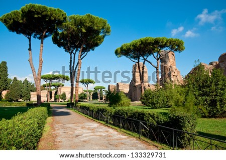 Path and trees from Caracalla springs at Rome - Italy - stock photo