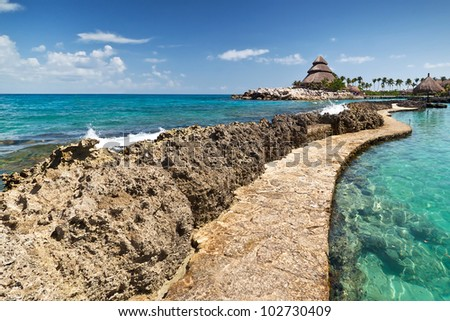 Path at the Caribbean Sea in Mexico - stock photo