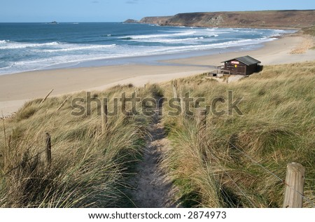 Path down to the beach at Sennen Cove, Cornwall, UK. - stock photo