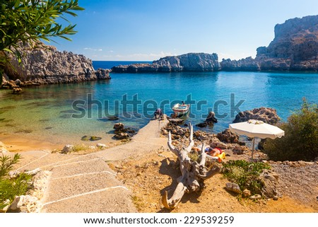 Path down to the beach St Pauls Bay at Lindos on the Greek Island of Rhodes Europe - stock photo