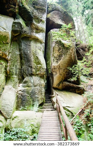 Path inside rocks with stairs - stock photo