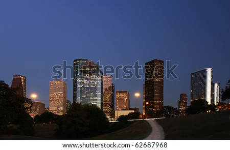 Path leading to Scenic Houston Skyline at Night - stock photo