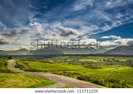 Path leading to the mountains in Scotland - stock photo