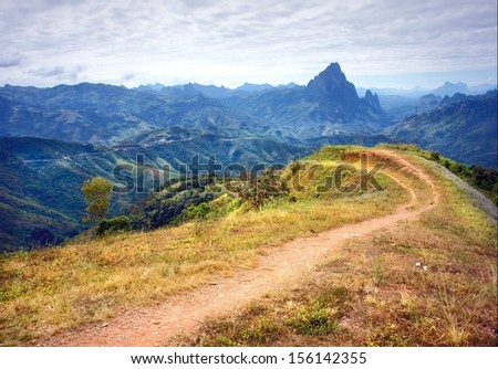Path leads to a impressive mountain landscape   - stock photo