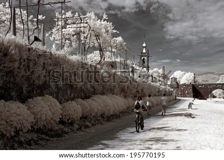 Path of the medieval town of Ponte de Lima, border of Lima river, Northern Portugal. Infrared. - stock photo