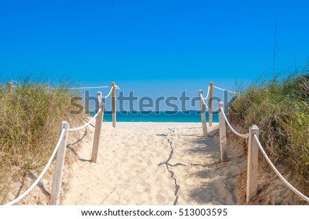 Path on the sand going to the ocean in Miami Beach, Florida