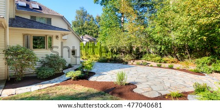 Path, patio and flowerbeds complete, with plants transplanted and mulched