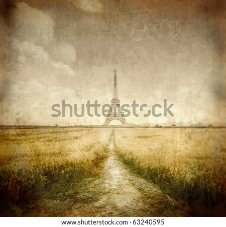 Path through a wheat field with Eiffel Tower on the background - stock photo