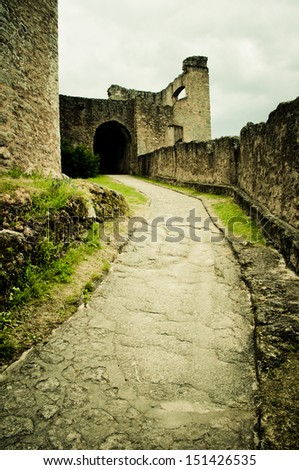path throught old castle - stock photo