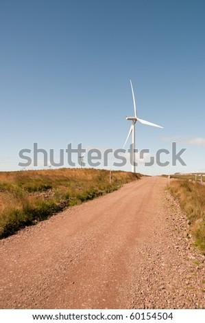 Path to a wind turbine on a wind farm in Scotland, Europe. - stock photo