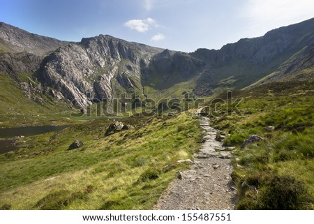 path to mountains in the summer sun, glyders, snowdonia, north wales - stock photo