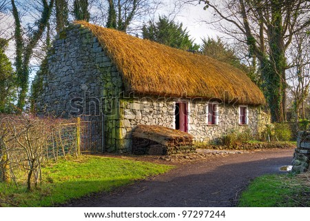 Path to old Irish cottage house - stock photo