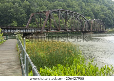 Path To RR Bridge In The Rain - stock photo
