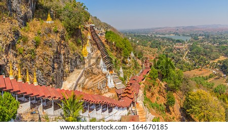 Path to the Pindaya caves, Buddhist shrine  where thousands of Buddha images have been consecrated for worship over the centuries. - stock photo
