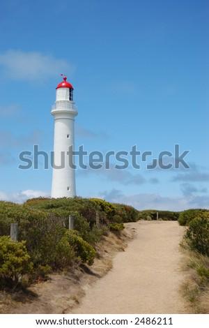 Path to white lighthouse - stock photo