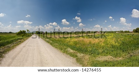 Path with field and white clouds panorama