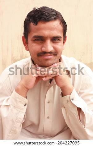 Pathan making pose for camera - stock photo