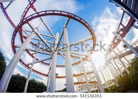 Pathum Thani, THAILAND - DECEMBER 13: Roller coaster with sunset blue sky background on DECEMBER 13,2016 ,Pathum Thani ,Thailand.