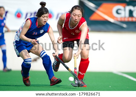 PATHUM THANI THAILAND-FEB 18:Chan Ching Nam (red) of Hong Kong  in action during Women's Asian Games Qualifiers 2014 Taipei  and Hong Kong at QueenSirikit Stadium on February 18,2014 in Thailand