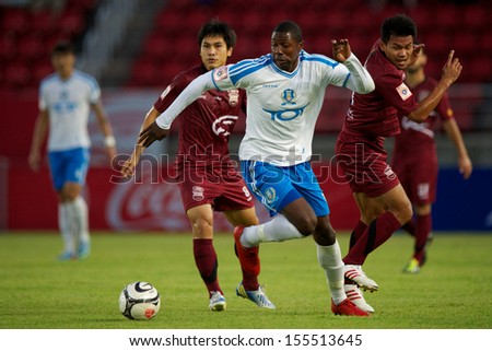 PATHUM THANI,THAILAND-JULY 21:Bas Savage (white) of  TOT SC for the ball during Thai Premier League between InseePolice UTD.and TOT SC.at Thammasat Stadium on July,2013 in Thailand