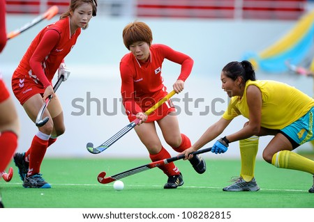 PATHUM THANI,THAILAND-JULY 3:Park Ju Hui (no.12 Red) of Korea fights for the ball during the Women�s Junior AsiaCup Korea and Kazakhstan at QueenSirikit Stadium on July3,2012 in PathumThani,Thailand.