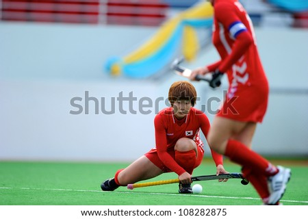 PATHUM THANI,THAILAND-JULY 3:Park Ju Hui (no.12 Red) of Korea in action during the Women�s Junior AsiaCup Korea and Kazakhstan at QueenSirikit Stadium on July3,2012 in PathumThani,Thailand.