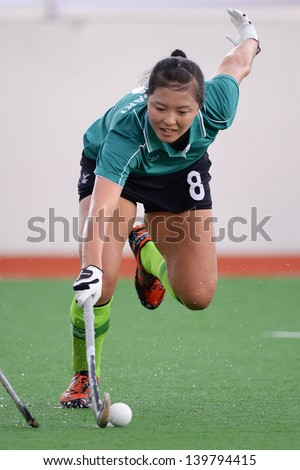 PATHUM THANI THAILAND-MAY 24:Han Taejeong of Kasetsart HC.in action during The PTT Thailand Hockey League between Kasetsart HC.and PTT Power at QueenSirikit Stadium on May 24,2013 in Thailand