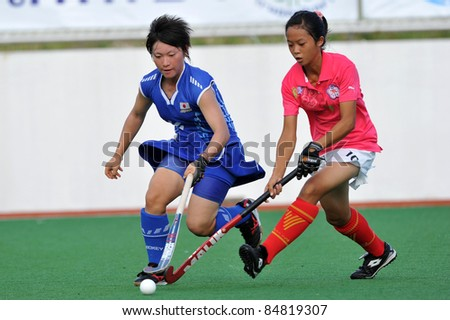 PATHUM THANI THAILAND-SEPTEMBER 16:Chen Pin-Yui(P) in action during ptt grils asia cup 2011(U18),Japan Vs Chi-Taipei at Commemoration Of Queen Sirikit Sports Stadium on Sep16,2011 in Pathum Thani Thai