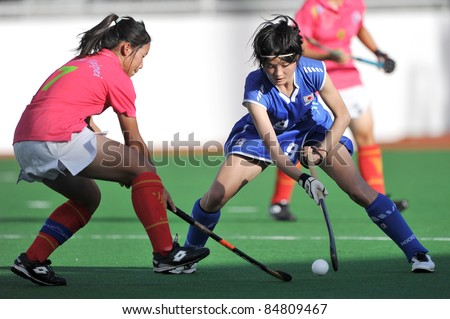 PATHUM THANI THAILAND-SEPTEMBER 16:I. Naho (B) in action during ptt girls asia cup 2011(U18) , Jap Vs Chi -Taipei at Commemoration Of Queen Sirikit Sports Stadium on Sep16,2011 in Pathum Thani Thai