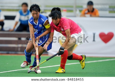 PATHUM THANI THAILAND-SEPTEMBER 16 :Mano Yukari (B)in action during ptt grils asia cup 2011(U18),Jap Vs Chi-Taipei at Commemoration Of Queen Sirikit Sports Stadium on Sep16,2011 in Pathum Thani Thai
