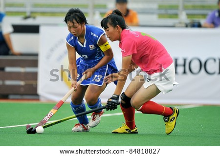 PATHUM THANI THAILAND-SEPTEMBER 16:Mano Yukari(B) in action during ptt grils asia cup 2011(U18),Japan Vs Chi-Taipei at Commemoration Of Queen Sirikit Sports Stadium on Sep 16,2011 in Pathum Thani Thai