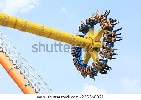PATHUMTANEE,THAILAND - NOVEMBER 30: People playing The Roller Coaster at Dream World on November 30, 2014. in Pathumtanee ,Thailand - stock photo